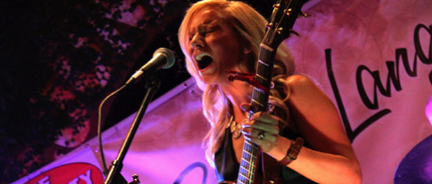 Bonnie Lang performing for crowd during CD release